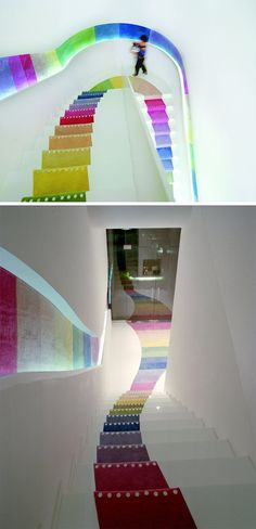7 Inspiring Examples Of Rainbow Stairs // The stairs in this book store are carpeted in rainbow colors.