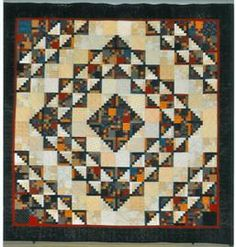 Susquehanna Valley Quilters 2012 raffle quilt. Interesting layout for a Log Cabin quilt.