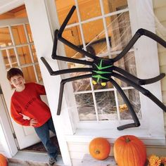 Craft your own spider with an empty milk carton, black duct tape and foam pipe insulation tubes