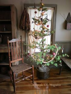 Love this Charlie Brown Christmas Tree.so simple yet so pretty Ladder Christmas Tree, Prim Christmas, Antique Christmas, Simple Christmas, Winter Christmas, Xmas Trees, Christmas Crafts, Natural Christmas, Father Christmas