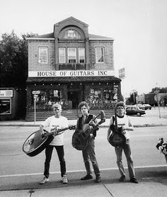 Blaine, Armand, and Bruce Schaubroeck in front of their House of Guitars in Rochester, NY