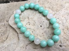 Gemstone Beaded Stretch Bracelet by My SoCal Creations. This Bracelet is made with 8mm Round Green Amazonite and White Jade Gemstone Beads. Bracelet measures 6.75. Makes a wonderful gift! Ready to ship for last minute shopping ;). Made on a strong stretch elastic cording. Thanks so