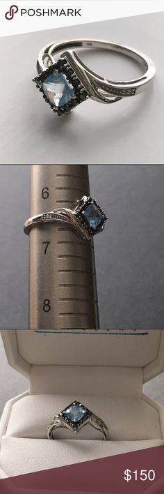 Blue Topaz and Black Diamond Ring Love this ring! Gorgeous blue Topaz and black diamonds set in 10k white gold.  Beautiful right hand ring. Size 6.5 (see picture).  Bundle with the matching necklace and save!! Jewelry Rings