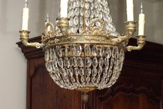 Bronze and Crystal Empire Chandelier with 6 arms   From a unique collection of antique and modern chandeliers and pendants  at https://www.1stdibs.com/furniture/lighting/chandeliers-pendant-lights/