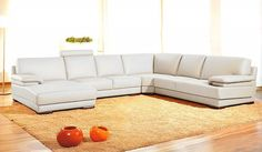 """- 'U' Shaped sectional - Headrests - Low profile style - Real leather in the front, high-quality leather match material on the back Dimension: 2 seaters with arm: W58"""" x D37"""" x H35/39"""" Corner: W44"""" x"""
