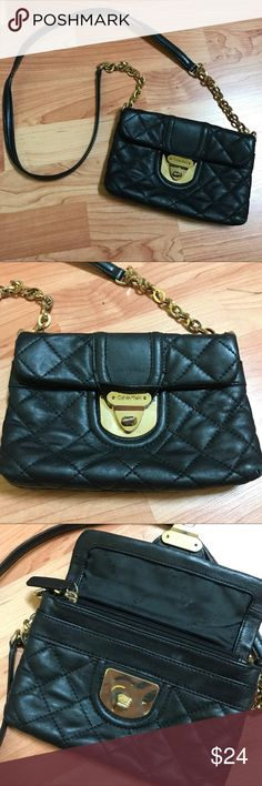 Calvin Klein Purse DONATING TO GOODWILL THIS SATURDAY, OCTOBER 28TH, IT MUST GO BEFORE THEN   Calvin Klein purse with gold details. Leather quilted material. Calvin Klein Bags Crossbody Bags