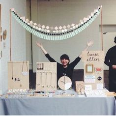 Love the garland that sits high above the craft fair table. Really catches the eye and fits with the brand