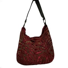 A rich velvet hobo bag, in Burgundy color with abstract appliqué work in woven textured fabric.  Leather handle, attached with rings. Three pockets in side. One with a zip closer.  A perfect pair with semiformal jackets and dresses. #Clutches #Satchel  #HandBag #purse #Clutchonline #LeatherBags #Gifts  #GiftsIdeas #Shoulderbag  #handbags #handbagseller #hobobag #Hobos #CrossBody #Handbags #LeatherWallets #WomensFashions #embroidery #bags