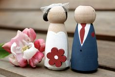 Custom Wooden Bride and Groom Wedding Couple for Gift or Cake Topper. £25.00, via Etsy.