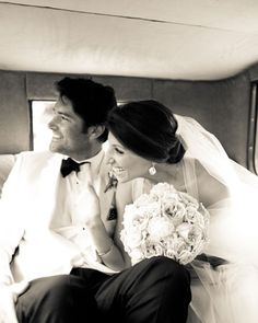 Bride and groom in the car - wonder what they are looking at?