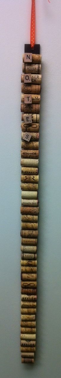 wine cork bulletin board. on a spray painted yard stick! attached scrabble tiles to thumb tacks. perfect for small spots in the house!