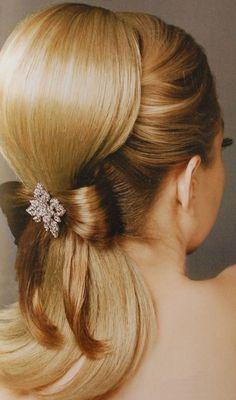 Wedding hair-do. A bit overdone, but still interesting.