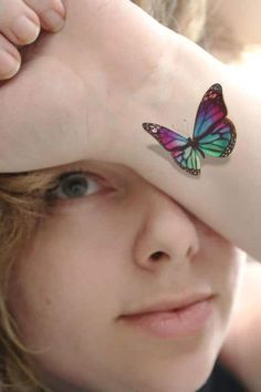If you are looking for butterfly tattoos for women, this piece is definitely worth considering. The use of color is amazing and the shading makes the creature looks like its folding its wings inwards, ready to take off.