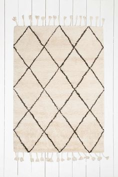Beni Ourain classic rug to lighten the space and pick up on the dark walls