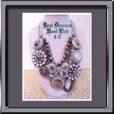 """AUTH. Betsey Johnson Statement Necklace (SOLD OUT IN STORES)BETSEY JOHNSON """"WHITEOUT"""" COLLECTION.  The necklace has a thick woven silvertone chain and leads to 4 rows. The first row is a beaded row of gray metallic beads. The second row is an antique goldtone chain with a large silvertone bow with rhinestones. The third row has a row of milk white beads. The last row is filled with large medallions covered in rhinestones, dangling chains, and a heart with rhinestones. Necklace measures at…"""
