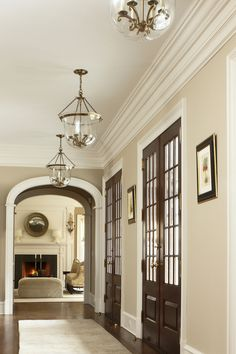 ZsaZsa Bellagio: At Home & Elegant  Love the combination of warm neutral walls, white mouldings & dark doors & floors.