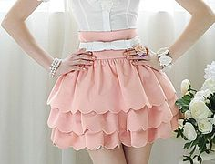 Sweet Kawaii Pink Shorts but looks like a skirt. Very Cute with back zipper.  (white belt not included)  Size: 28in. waist; 16in. long
