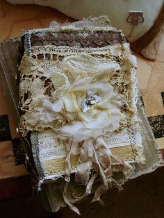 journal front with flower. Made with fabric and paper, trims and buttons. All hand bound. See my Etsy shop.