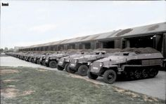 A long row of brand new German light and medium half-tracks (Sd.Kfz. 250 and Sd.Kfz. 251) in front of a factory near Berlin, 1942.