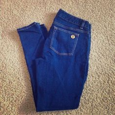 """Michael Kors Straight leg jeans Dark navy Jean, with zipper pockets in the front, a Michael Kors gold emblem on the back pockets. Never been worn. Says size 4, but can fit a size 6. Pant length from crotch: 28"""". Length from waist: 34.5"""" Michael Kors Jeans Straight Leg"""