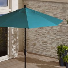 Shop 9' Round Sunbrella ® Bold Turquoise Patio Umbrella with Tilt Black Frame.  With a Bold Turquoise umbrella canopy in fade- and mildew-resistant Sunbrella acrylic, our easy-tilt umbrella follows the sun all day, blocking out 98% of UV rays.