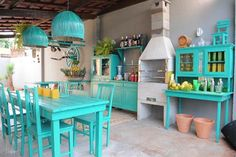 Our kitchen is not this bare but many homes in Aruba are, especially charming cunucu homes. beach colors on washed out rustic design.stripped room w/ add ons Garden Furniture, Vintage Furniture, Painted Furniture, Outdoor Furniture Sets, Outdoor Decor, Rustic Design, Rustic Decor, Turquoise Chair, Turquoise Kitchen