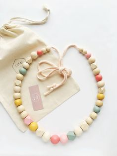 wooden bead garland with natural and handpainted by coralandcloud
