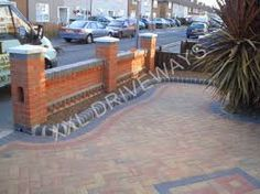 Imperial red brick London wall stone pier caps sandstone paving
