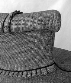 Feminine details on an upholstered chair.