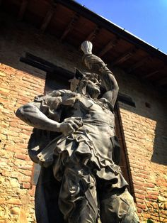 """Another statue that caught my attention as I walked through the narrow street lined with houses on both sides - """"Instagraming Grazzano Visconti"""" by @Norbert Mierzwa Figueroa"""