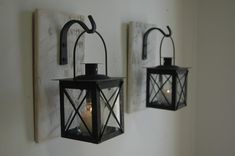 Black Lantern Pair with wrought iron hooks on recycled wood board for unique…