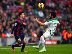 ionel Messi of FC Barcelona competes for the ball with Jose Angel Crespo Rincon of Cordoba CF during the La Liga match between FC Barcelona and Cordoba CF at Camp Nou on December 20, 2014 in Barcelona, Spain.Lionel Messi Photos: FC Barcelona v Cordoba CF - La Liga