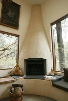 Corner, cob fireplace in a straw bale home with sitting ledge. – English Home Adobe Haus, Eco Buildings, Architecture Design, Natural Homes, Straw Bales, Earth Homes, Natural Building, Earthship, Sustainable Living