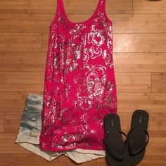 "🎊HPx2🎊Express Long Sequin Tank This tank is hot pink/magenta with silver sequin flowers on the front. It has been worn once and is in great condition. It is approximately 14"" across bust when laid flat and 32 1/2"" from shoulder to hem. 52% cotton, 48% modal Express Tops Tank Tops"