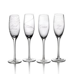 """$34.99-$59.00 Mikasa Cheers Bridal Party Toasting Flute Set features four unique patterns, each inscribed with the titles of the primary bridal party members: """"Bride,"""" Groom,"""" """"Maid of Honor,"""" or """"Best Man."""" The whimsical designs of the patterns combined with the wedding party titles add a lively touch of merriment to any wedding celebration."""