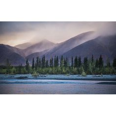 Rain and snow squalls race over the mountains during sunset on the Kelly River in the western Brooks Range of Noatak National Preserve Alaska USA Canvas Art - David Shaw Design Pics (38 x 24)