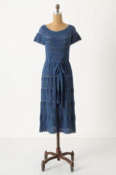 Blue crochet cotton dress in open-work bands. Ballerina neckline, short flutter sleeves, and below-knee a-line skirt. By Corey Lynn Calter for Anthropologie.