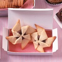 These rich, crisp cookies are filled with a creamy chocolate-hazelnut spread (available at most supermarkets), and folded into a pretty pinwheel shape.