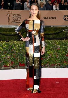 Alicia Vikander The Danish Girl actress, who took home an award for her performance in the film, sparkled in a mixed metal color-blocked column gown by Louis Vuitton. 2016 SAG Awards
