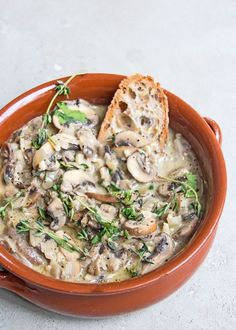 Creamy garlic and thyme mushrooms, cooked with fresh herbs, garlic, onions and natural (coconut) yoghurt and served on crusty toast - perfect easy supper when you're busy!