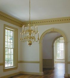 Crown moldings and arched doorways.