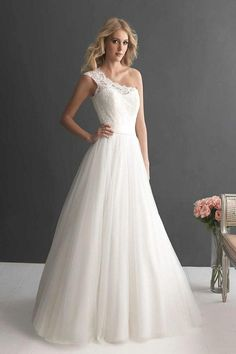 A spin on the classic A-line wedding dress, we love the one shoulder detail! Photo via Bridal Guide