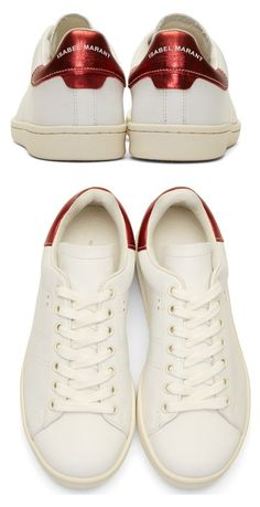 White Leather Bart Sneakers by Isabel Marant. Buffed leather low-top sneakers in white. Round toe. Tonal lace-up closure. Metallic red leather trim at heel collar with logo printed in white. White rubber sole. Tonal stitching. http://www.zocko.com/z/JEkNa