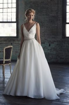 RHODA Ultimate ball gown whimsy in voluminous drape v-neck 50s ball gown cinched at the waist falling into pleated skirt fullness. http://www.michelleroth.com/bridal-gowns/rhoda/