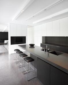 Sleek kitchen area in the Villa V & V in Bonheiden by Arjaan de Feyter _ En dan de kasten door laten lopen naar boven