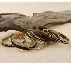@Overstock - Stay stylish and chic with this set of 12 stackable bangles. These beautiful bangles feature goldtone brass and wooden construction in an eye-catching design.http://www.overstock.com/Worldstock-Fair-Trade/Set-of-12-Brass-and-Wood-Brown-Bijoux-Bangles-India/5704224/product.html?CID=214117 $15.99