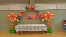 Flowers with polka dot arch and custom banner balloons milwaukee Balloonee Toonz Franklin, WI Home