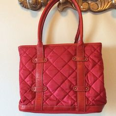 """WEEKEND SALE J.Crew nylon & leather tote Really cute red quilted nylon and red leather trim.   Very nice condition.  Bag has been cleaned, but a few small marks on lining.  Inside has zippered pocket and two open pouches.  Unsnap on sides to expand size.  Snap closure.  8"""" strap drop.  022904.  12"""" front/back panels, 10"""" tall, 7"""" side panels when unzipped J. Crew Bags Totes"""