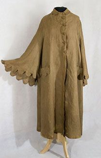 Linen duster cape, c.1900. Our duster cape offered a protective cover for the first adventurous passengers or drivers in the new horseless carriage, which was often topless. The duster is sleeveless under the outer cape collar and has wonderful scalloped edges on the collar, pockets, and outer cape. The self-covered buttons in the front and on the pockets are miraculously all there. The cape is an important historical artifact that displays beautifully.