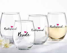 """Bride and Bridesmaids Pink Heart 15 oz. Stemless Wine Glass (Set of 4). For you and your girls, show off your group with ours Bride and Bridesmaid Pink Heart 15 oz. Stemless Wine Glasses! With a glass just for you showing your title of """"Bride"""" and three """"Bridemaid"""" glasses for your girls, you can love sipping during your wedding planning sessions, your shower, or your bachelorette party! This wine glass set is an excellent for a bridal party gift no matter how large your party may be…"""